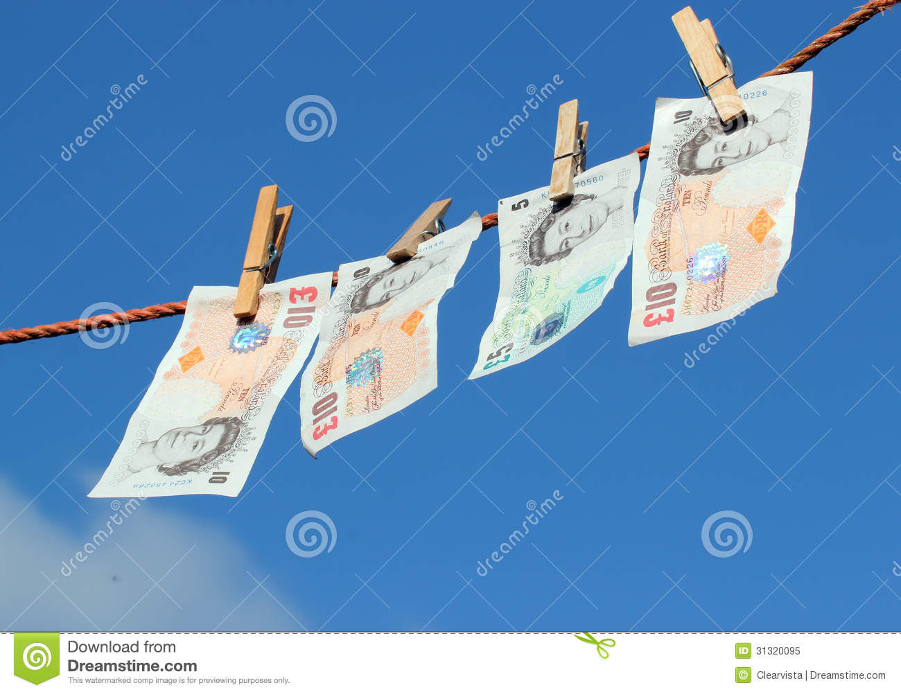 Money hanging on a washing line, possibly money laundering.
