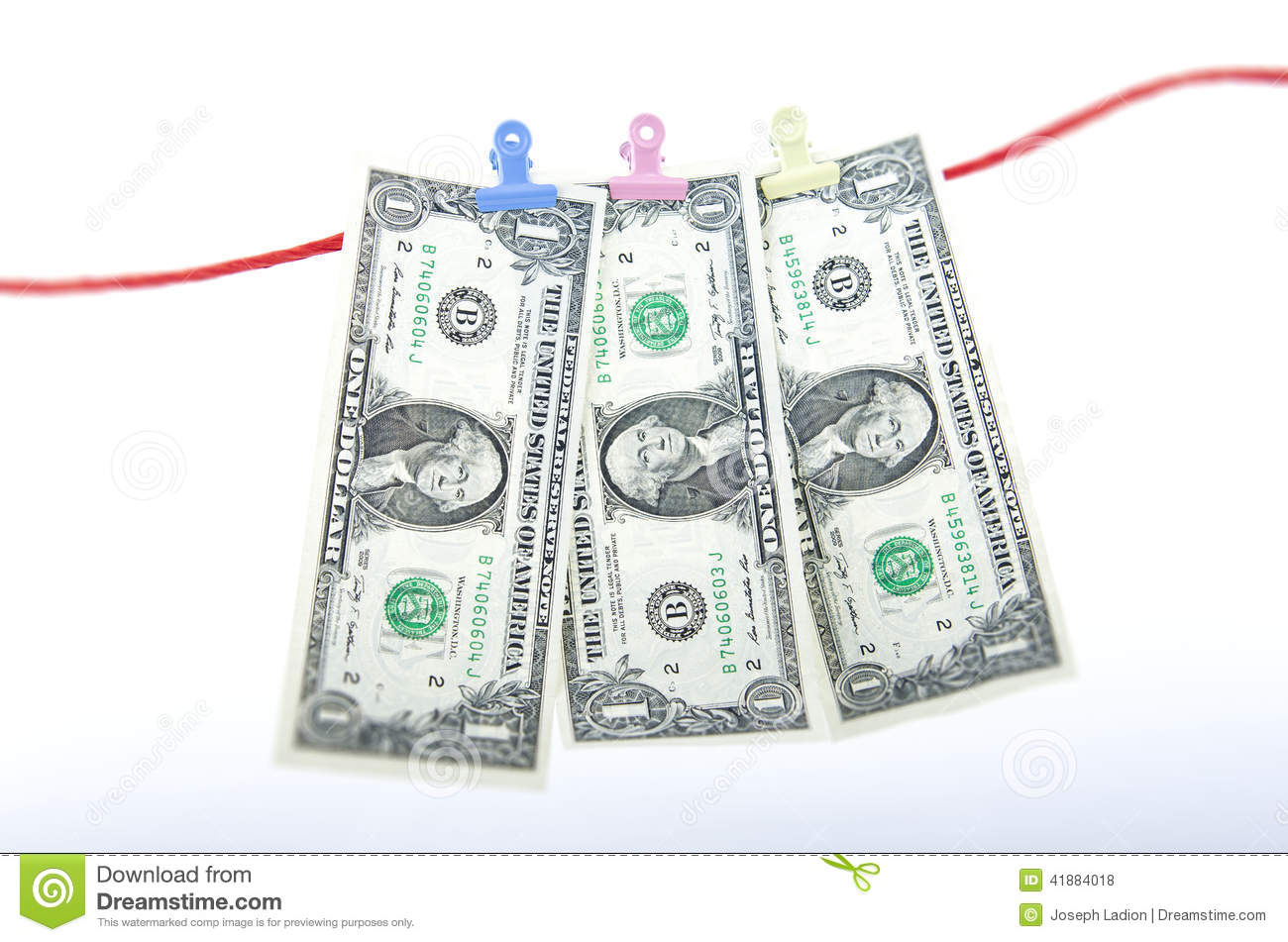 MONEY HANGING BY A WIRE stock photo. Image of profit - 41884018