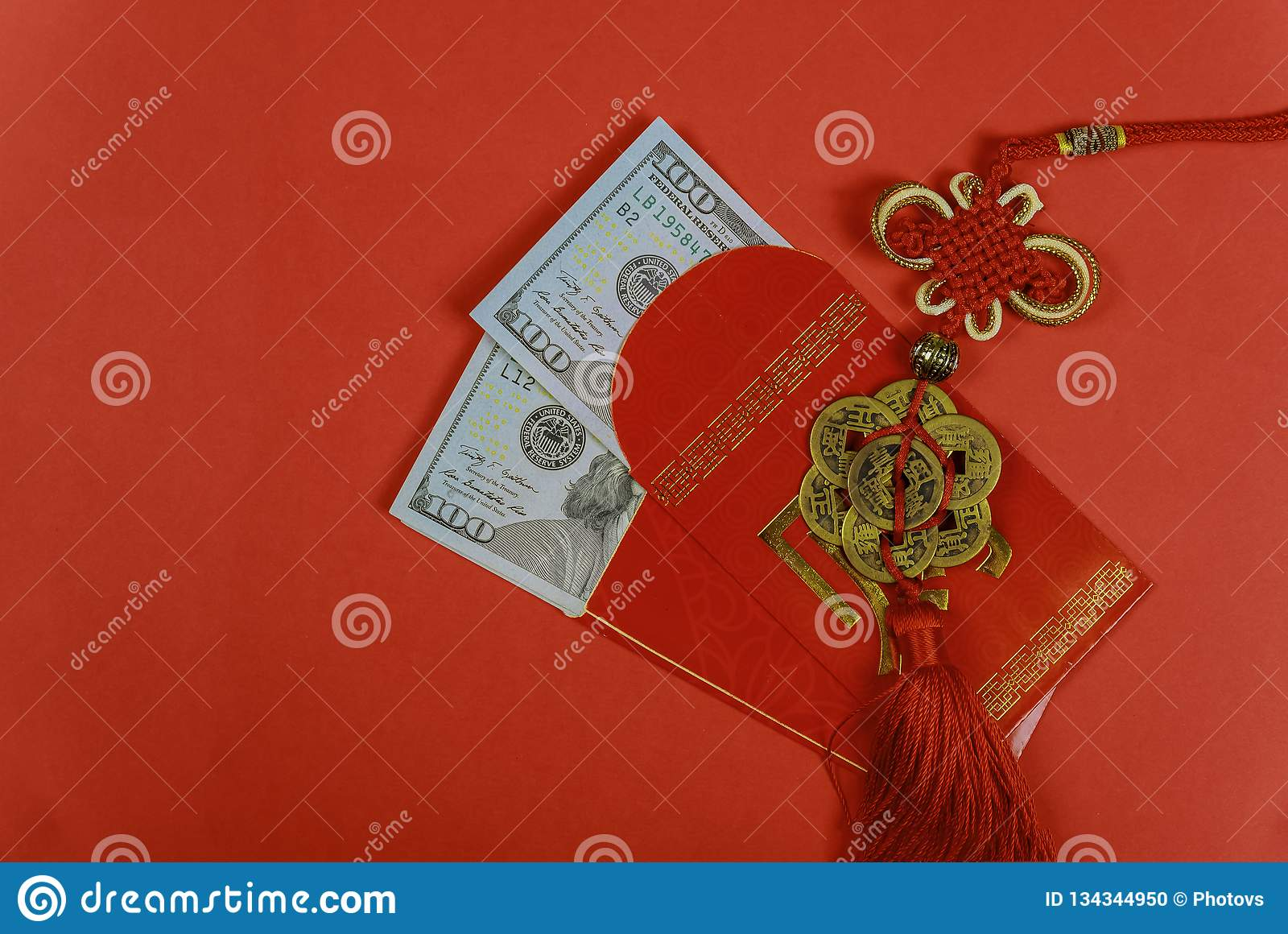 Money in red envelopes Chinese new year greeting gift, closed up of US dollar banknotes in red traditional envelopes