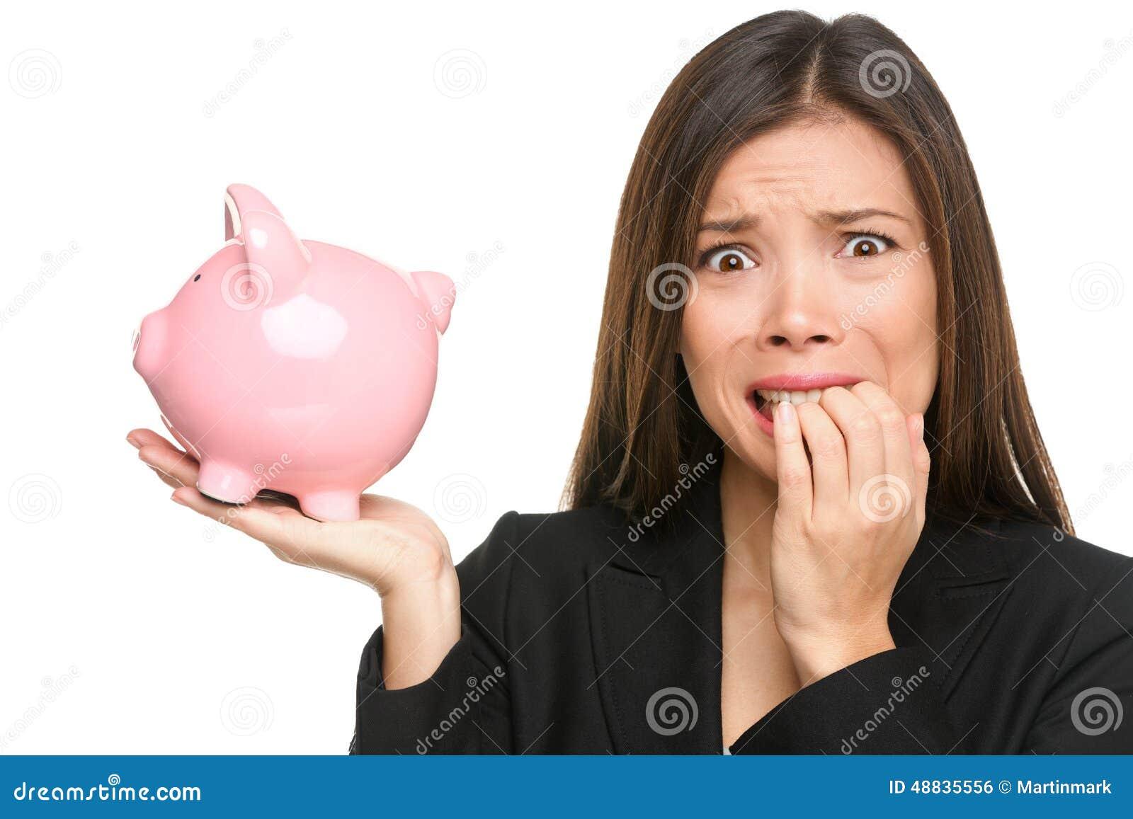 Money stress - business woman holding piggy bank