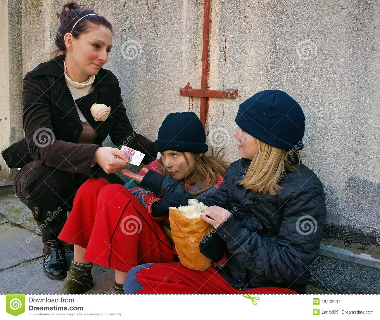 Money To Children Beggars Royalty Free Stock Photography