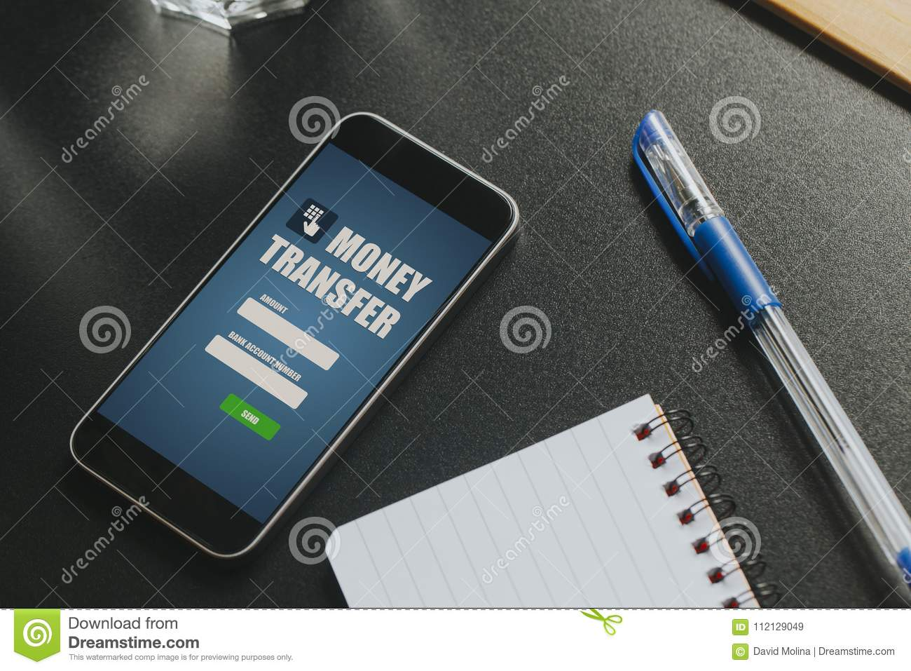 Money transfer app in a mobile phone screen over a black business royalty free stock photo reheart Gallery