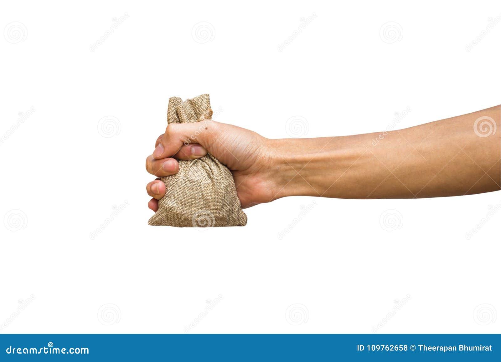Moneybag εκμετάλλευσης χεριών ατόμων, καφετί sackcloth που απομονώνεται στο λευκό