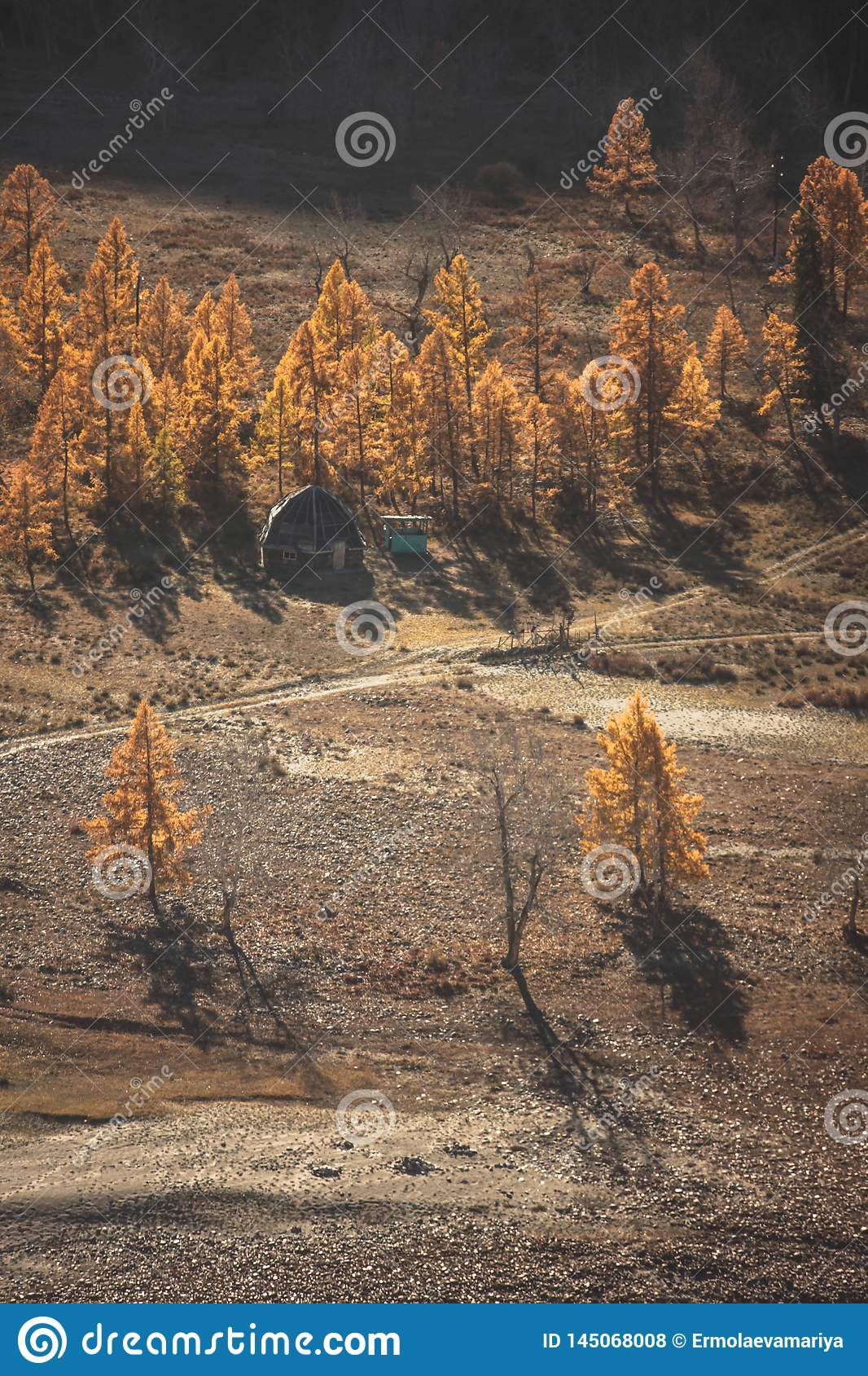 Mongolian Yurt And Ruined House Near The Large Mountain Autumn