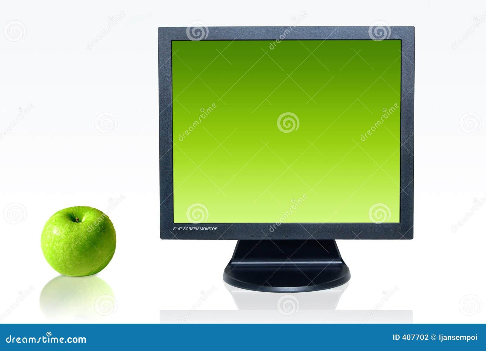 Moniteur et pomme verte photo stock Image du detail ordinateur