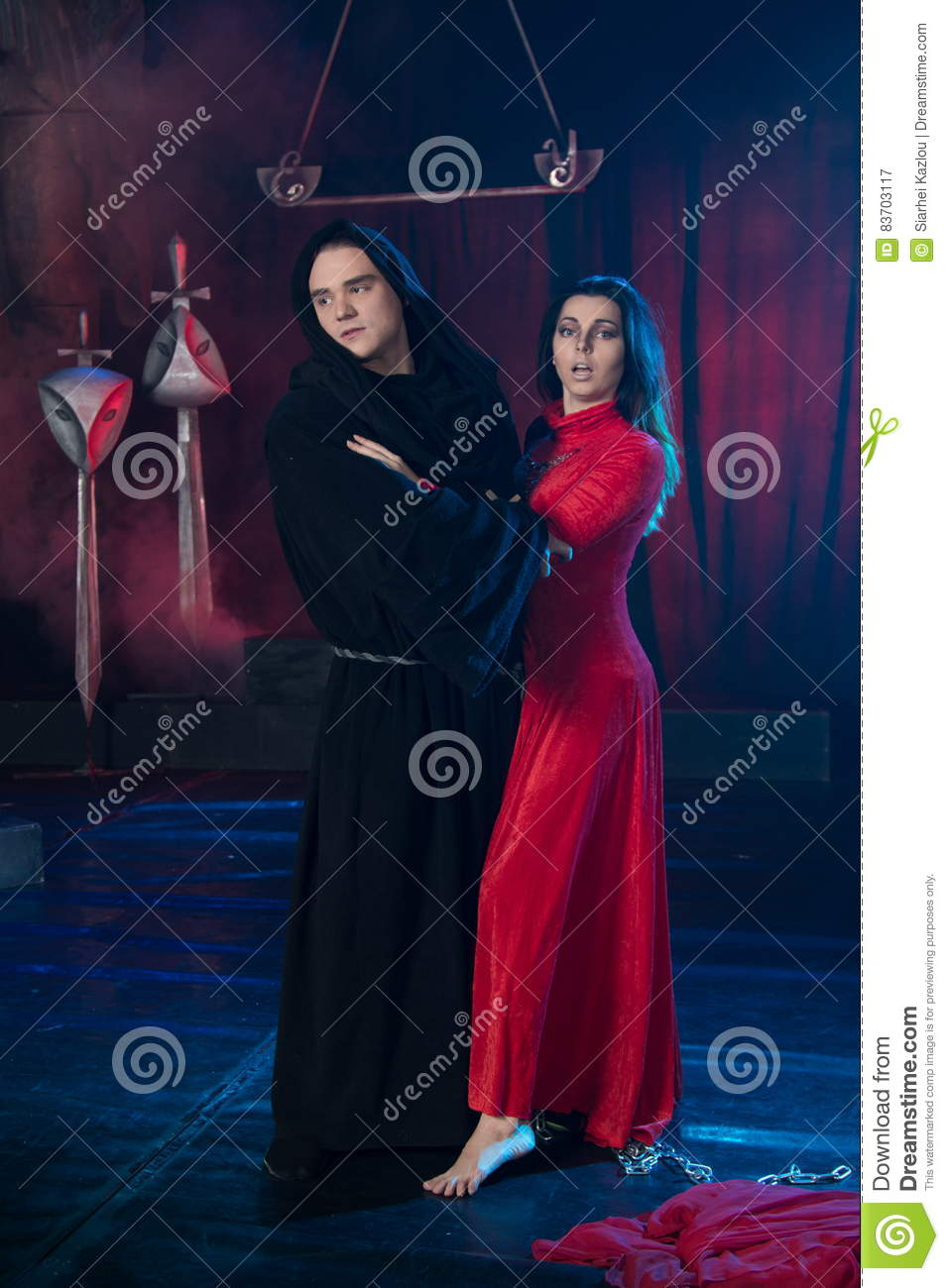 Monk Male And Female Beauty In A Red Dress. Stock Photo