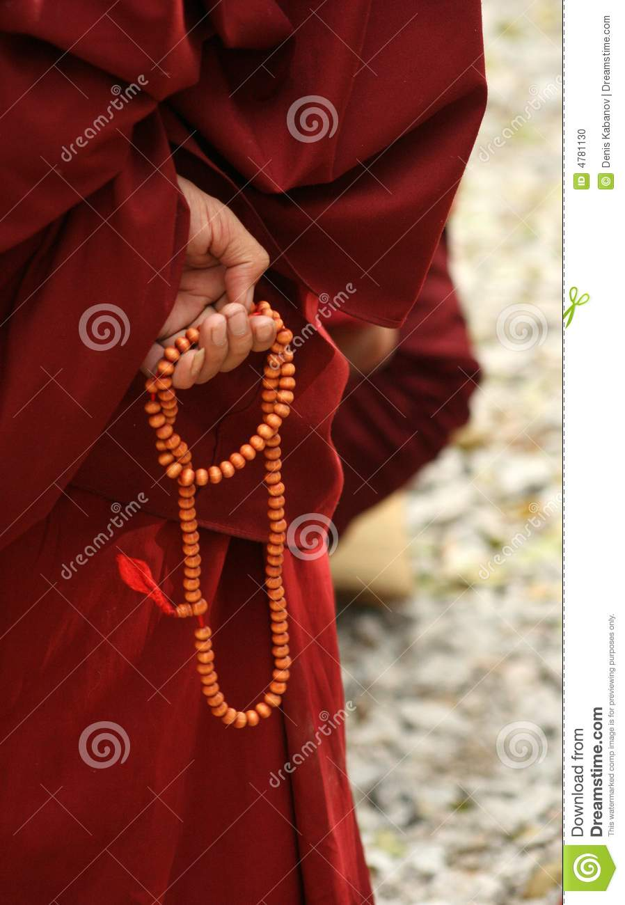 Monk s hand with bead