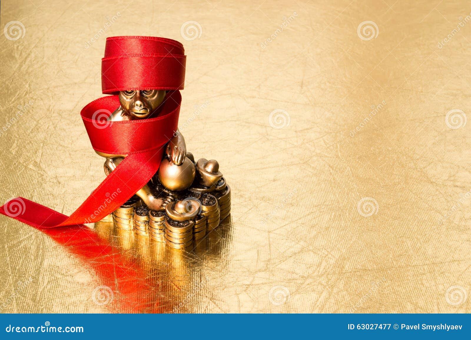 Monkey le symbole de la nouvelle année chinoise 2016, et le ruban rouge
