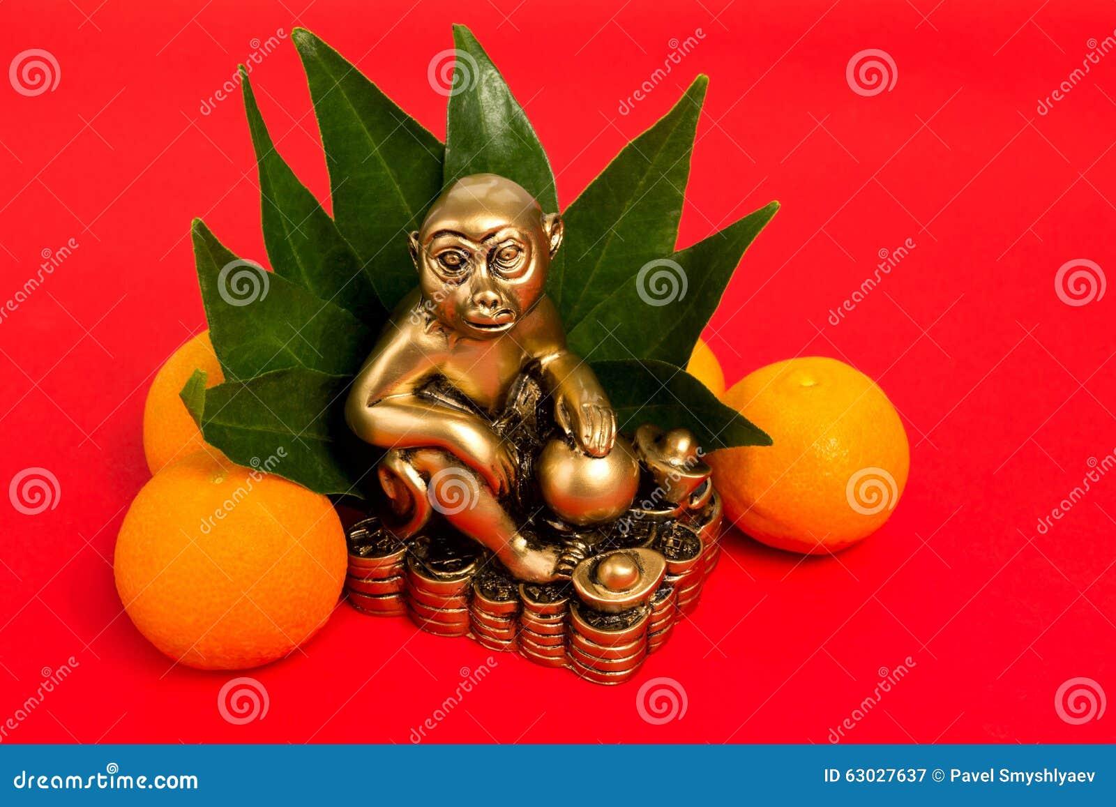 Monkey le symbole de la nouvelle année chinoise 2016, et les mandarines