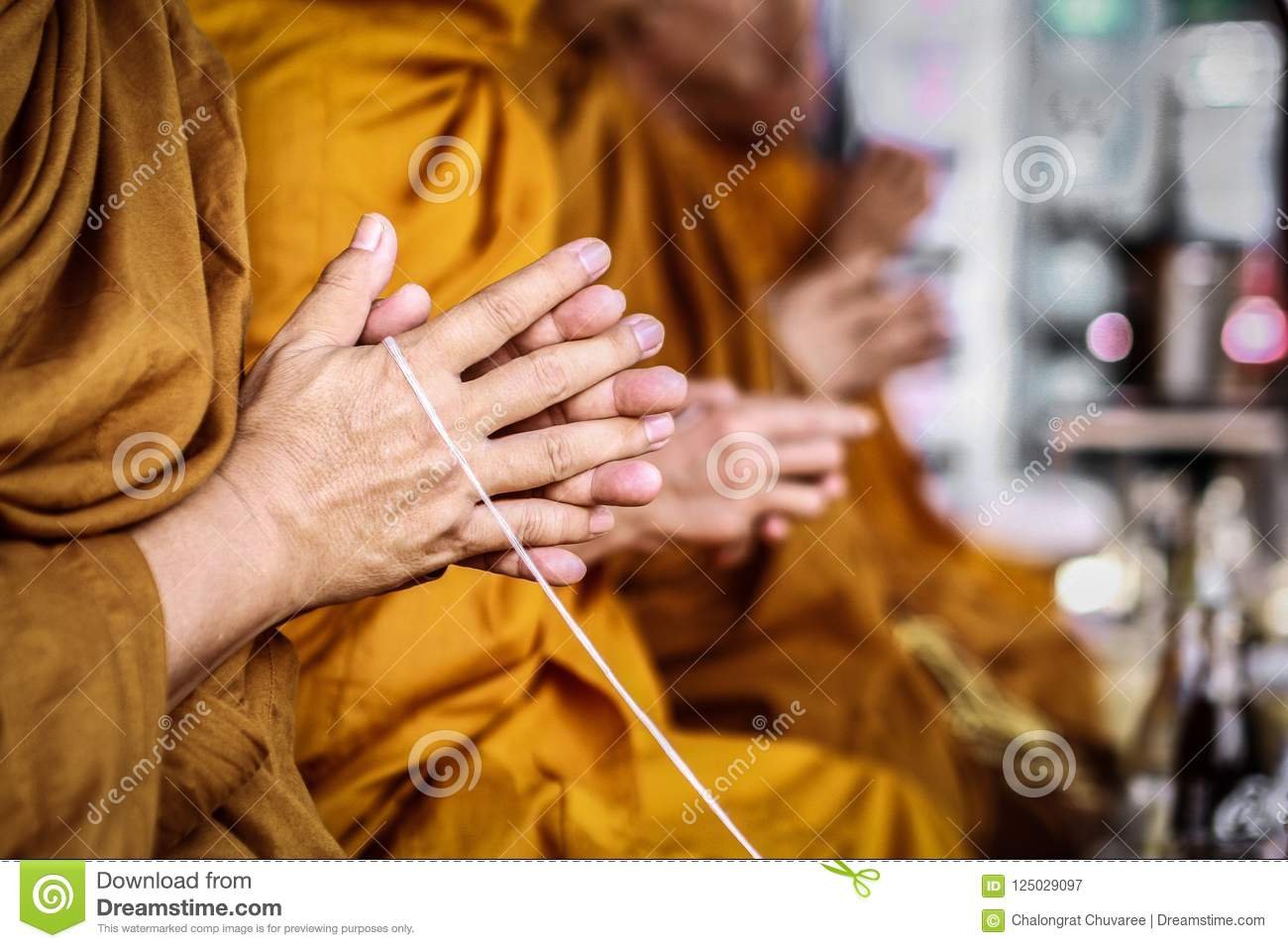 Monks chant on background blurred