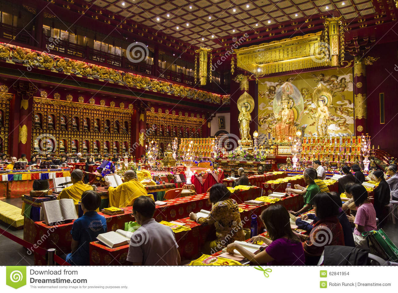 Monks Praying In Buddhist Temple Editorial Stock Image