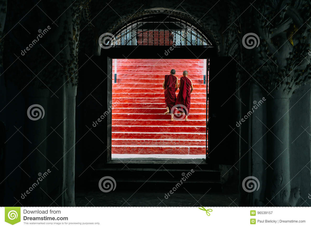 2 monks walking up stairs in Mandalay.
