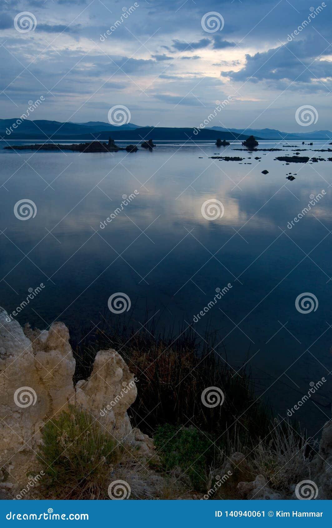 Dawn slowly lightens the morning sky bove the Tufa Reserve at Mono Lake, California.