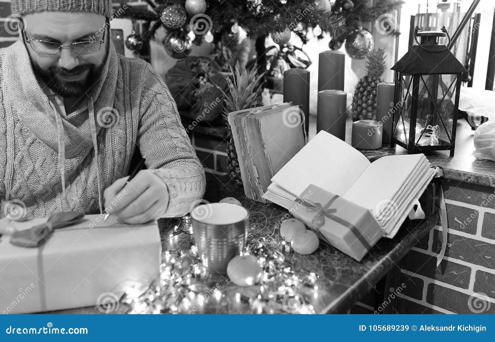 Monochrome Beard Man Writing Christmas Gifts On A Table Stock Image ...