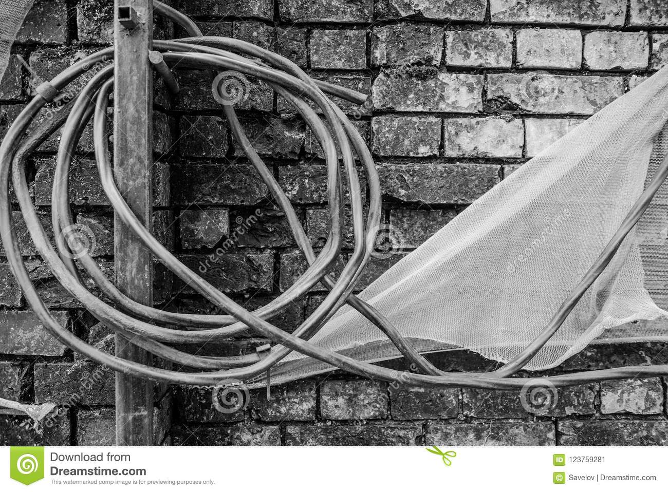 Black And White Photo With A Broken Brick Wall, Wound Wire And Cloth ...