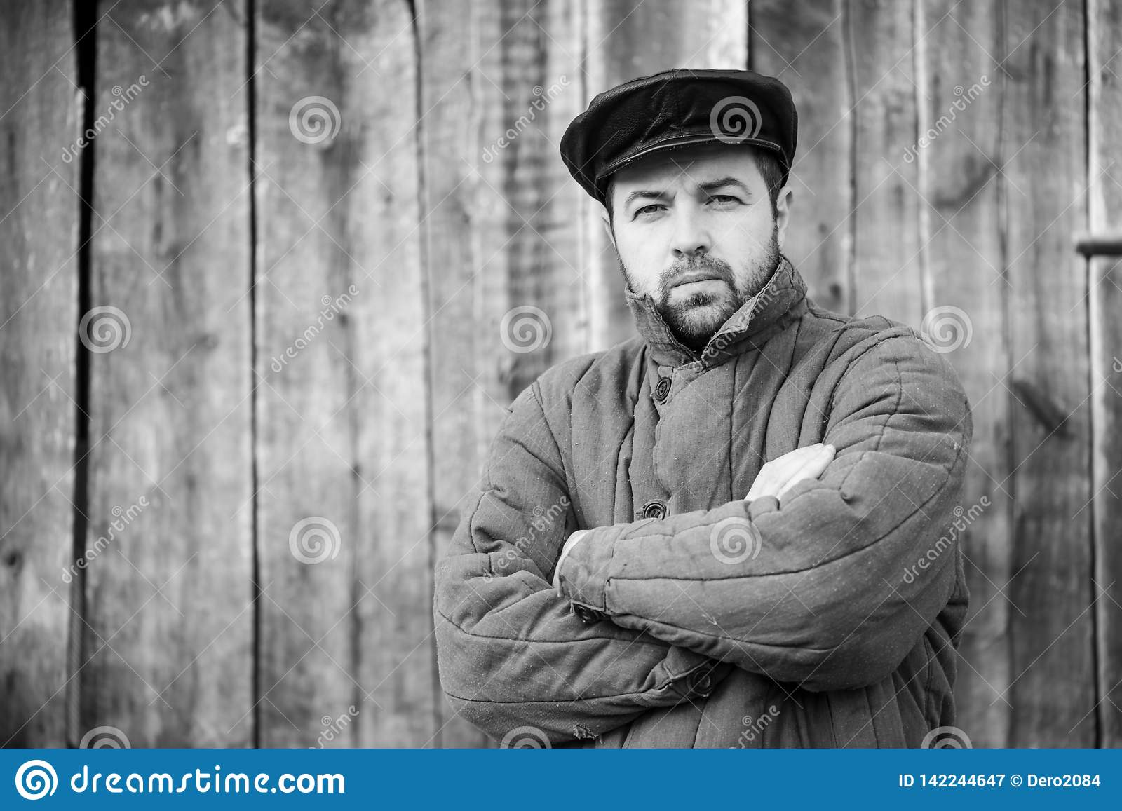Monochrome portrait of bearded men in old-fashioned clothes, caucasian man 35 years old