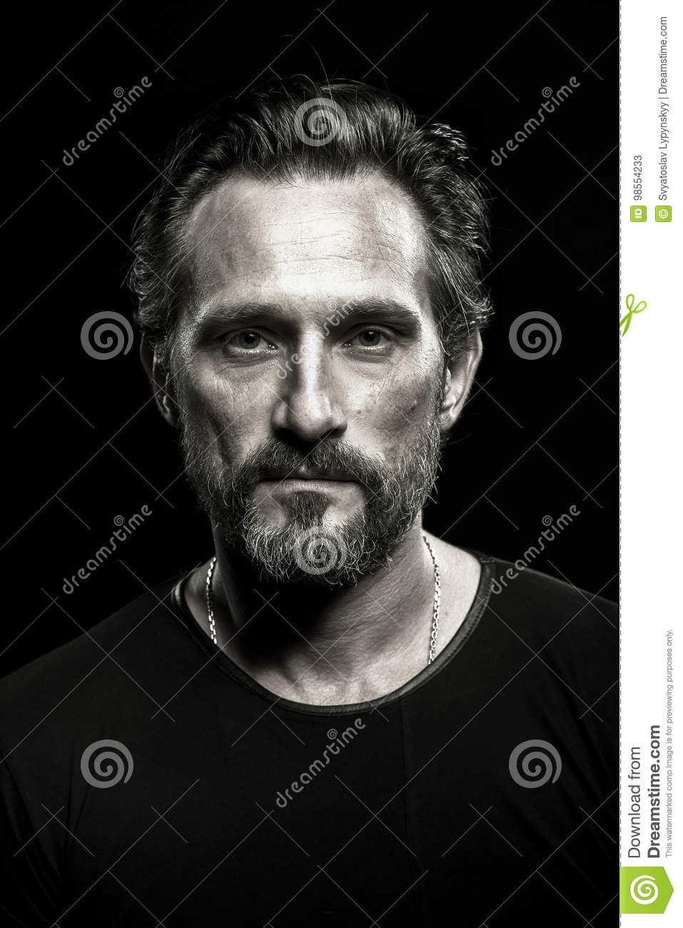 Monochrome portrait of strong mature beardy man.