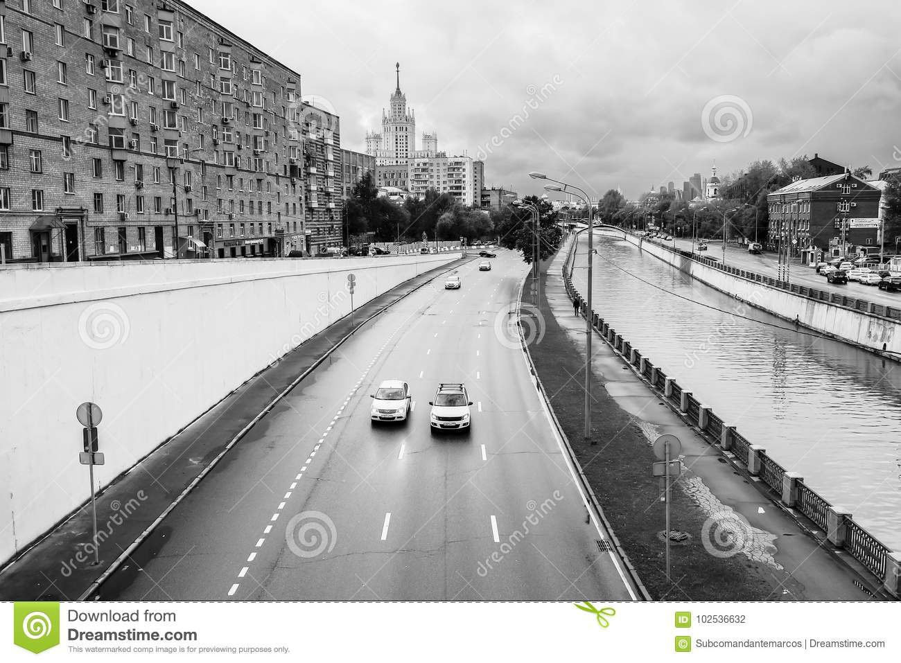 Monochrome urban landscape. View of the river Yauza and its embankments on rainy day, Moscow, Russia.