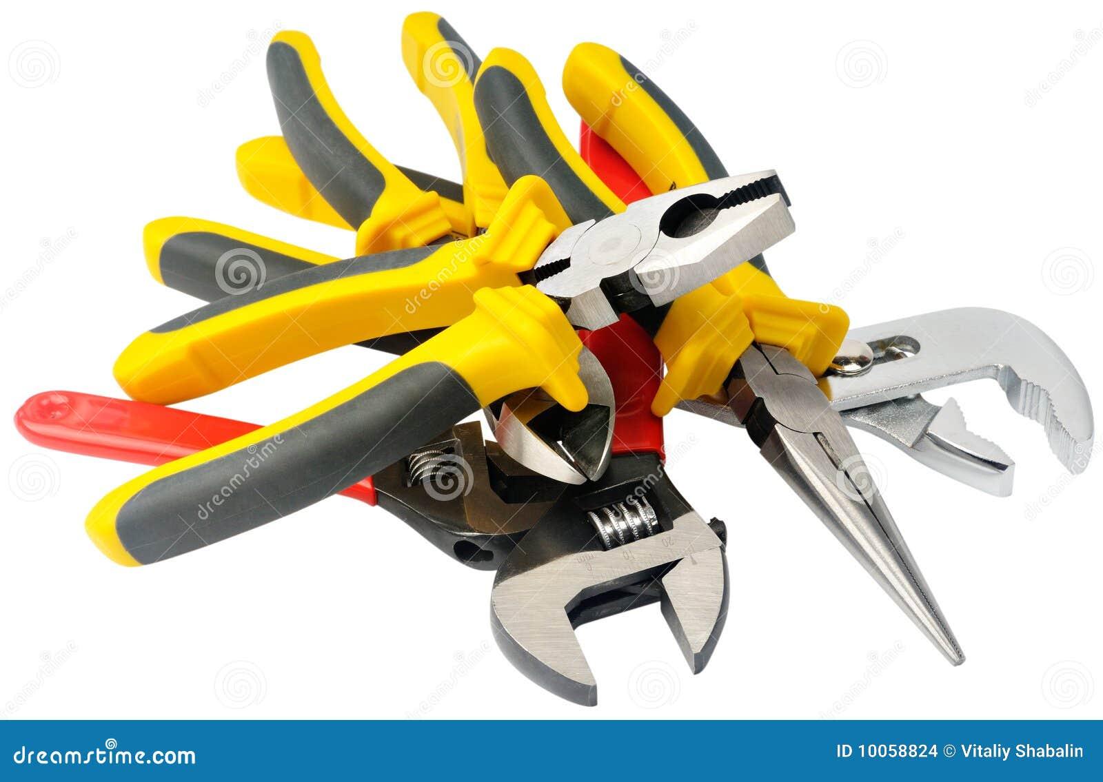 Montão das ferramentas de aço isoladas no branco