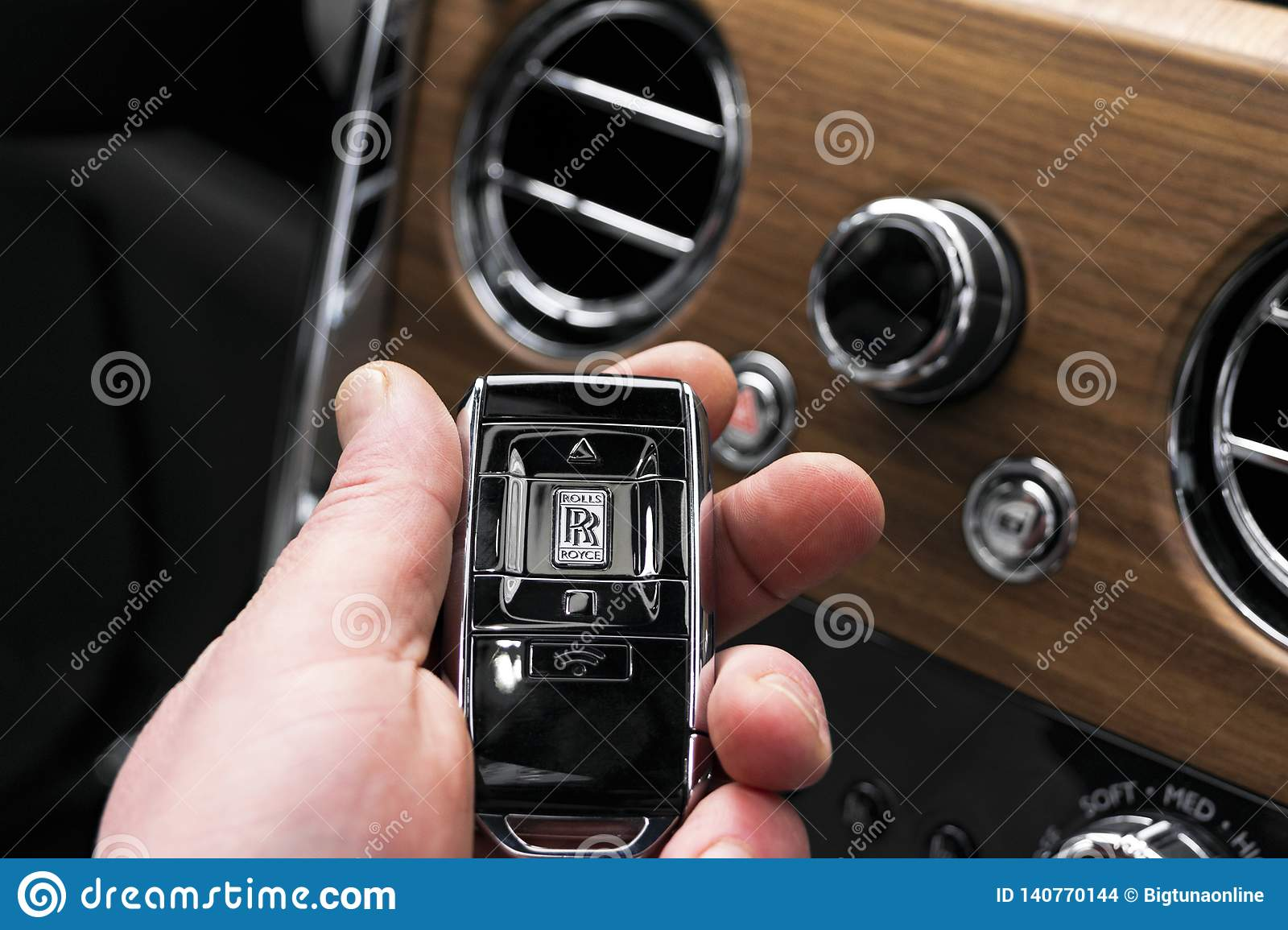 The New Rolls Royce Cullinan Wireless Keys In Male Hand Interior With Natural Wood Panel Rolls Royce Cullinan Luxury Suv Wireles Editorial Stock Image Image Of Driver Handle 140770144