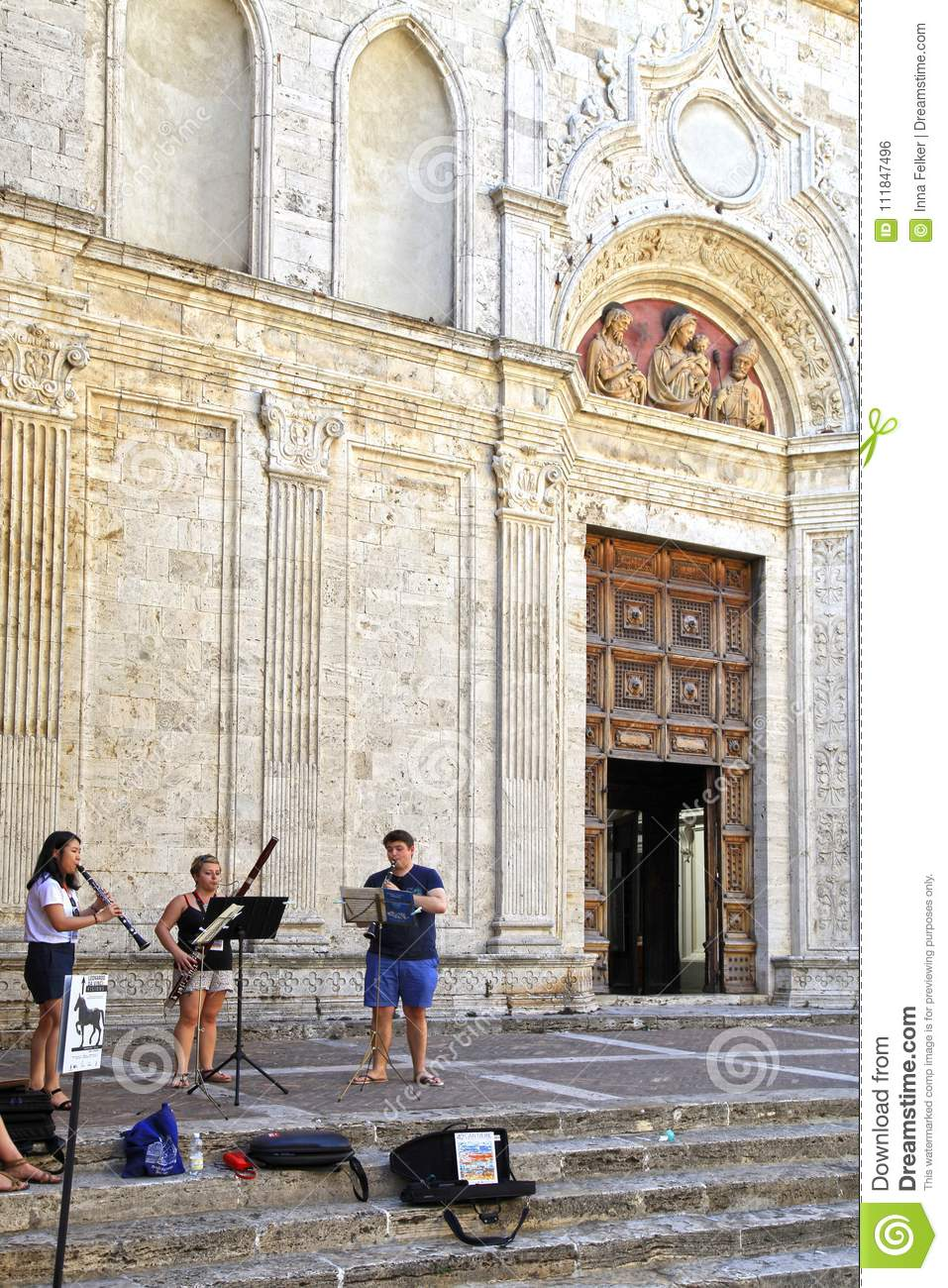 Street musicians on steps of Cathedral in tuscan town Montepulciano, Tuscany, Italy