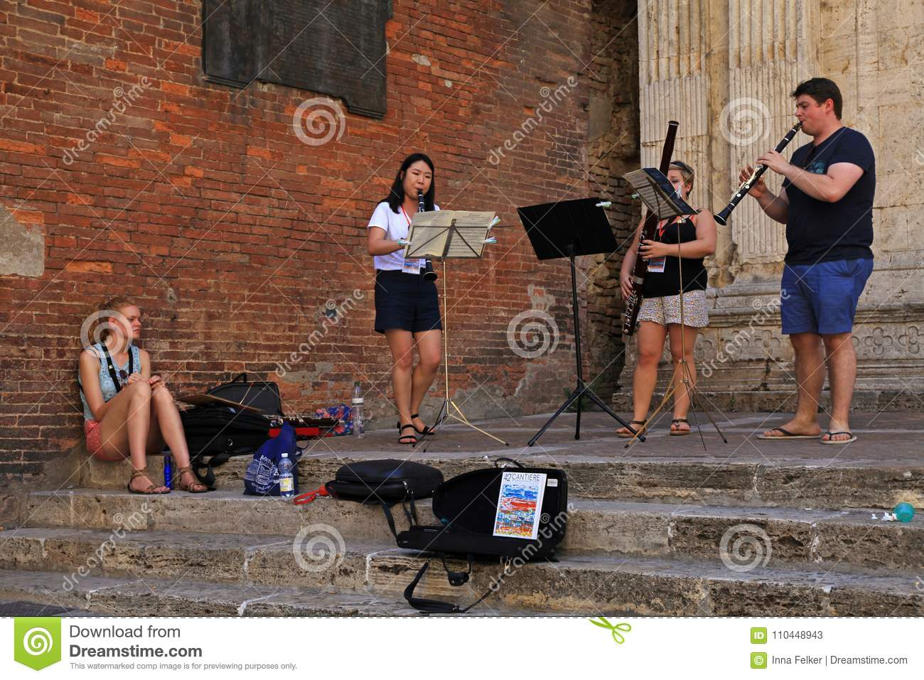 Street musicians in Tuscan town Montepulciano, Italy