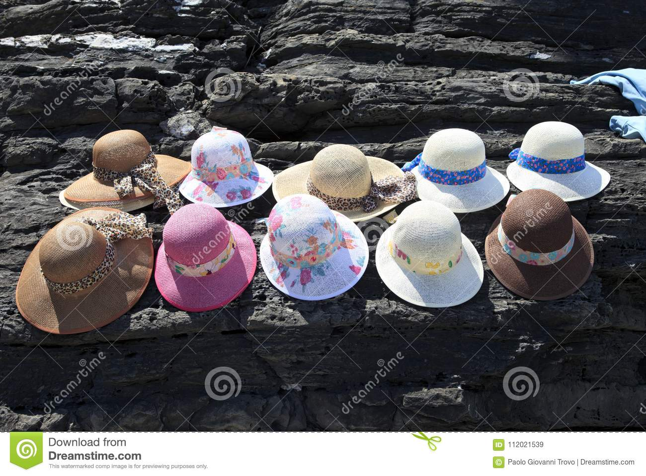 139e253152d052 Monterosso SP , Italy - April 15, 2017: Hats near a souvenir shop in  Monterosso village, gulf of Poets, Cinque Terre, La Spezia, Liguria, Italy