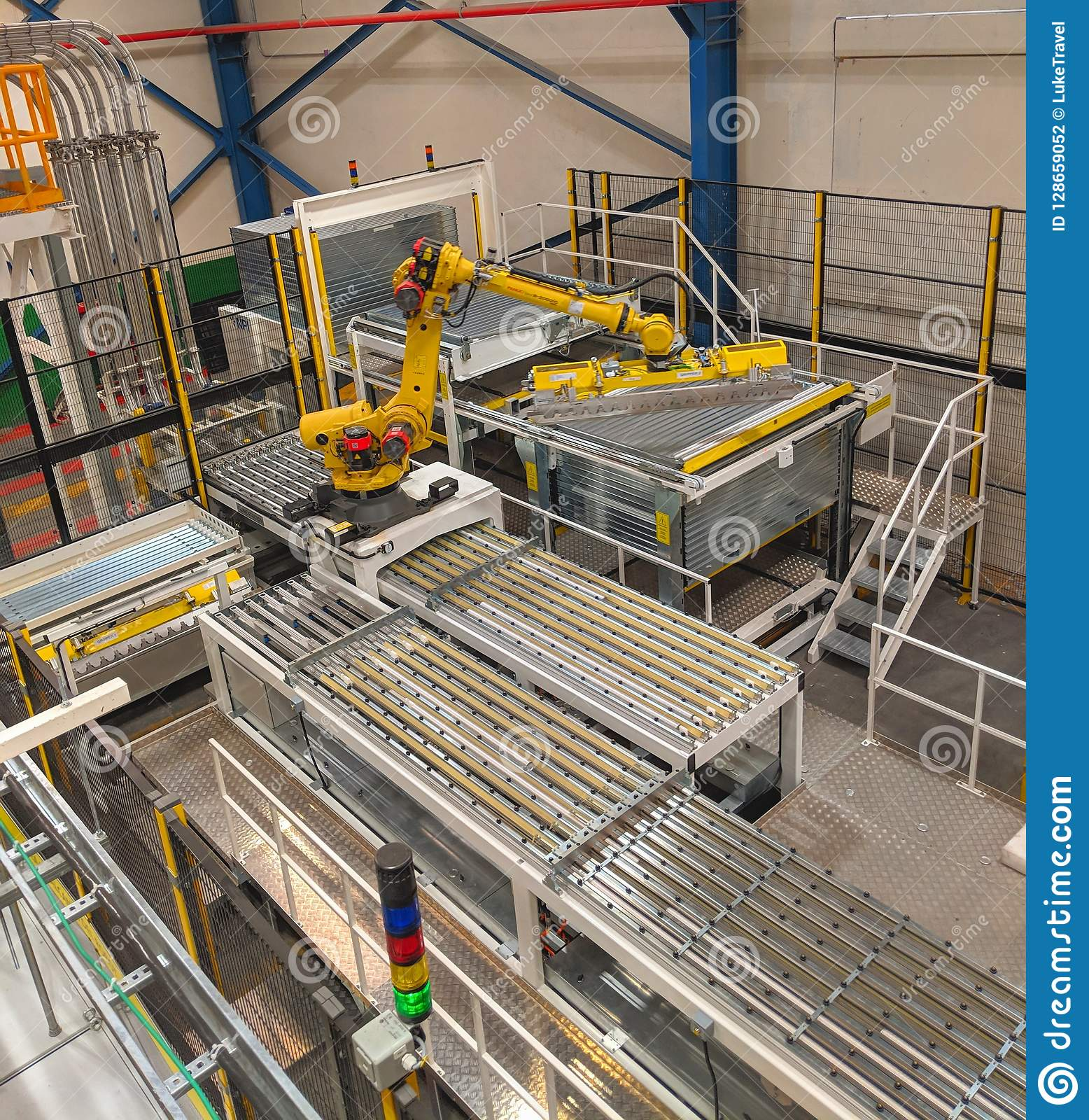 Robot In Can Manufacturing Plant Editorial Photography