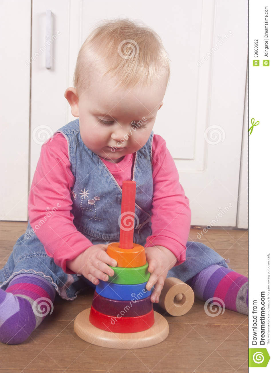 1 To 18 Month Toy : Month old babby playing with wooden toy stock photo