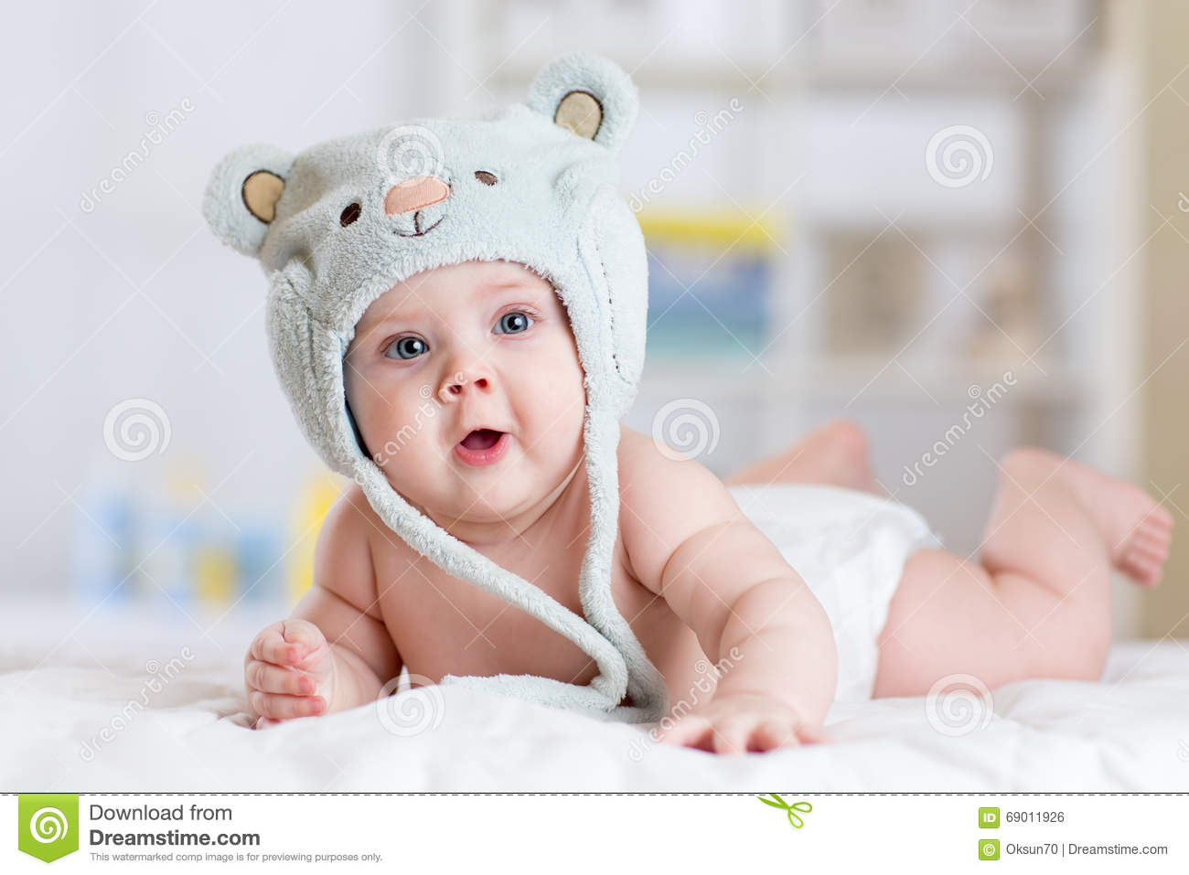 5 Months Baby Girl Weared In Funny Hat Lying Down On A
