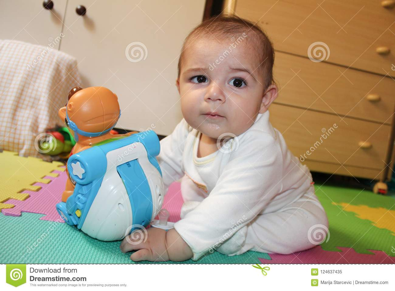 b2b047b3eb6 6 Months Old Baby Boy Playing With Toys Stock Image - Image of ...