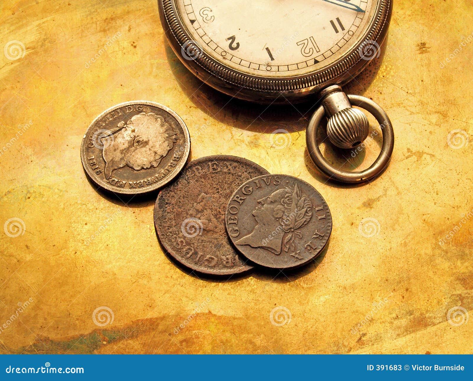 Montre et vieilles pièces de monnaie
