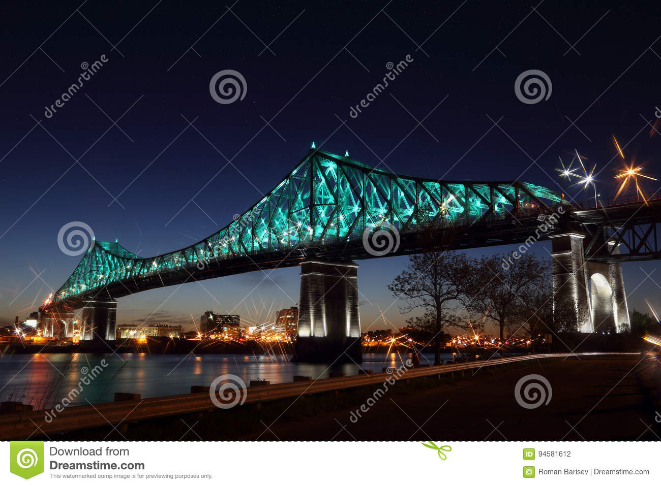 Montreal's 375th anniversary. Jacques Cartier Bridge. Bridge panoramic colorful silhouette by night