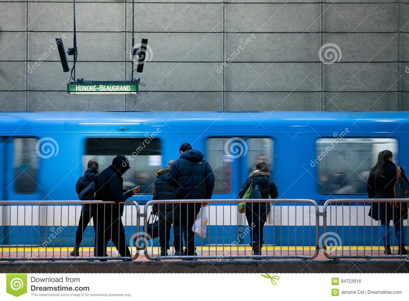 MONTREAL, CANADA - DECEMBER 29, 2016: People waiting for a Metro in Lionel Groulx station