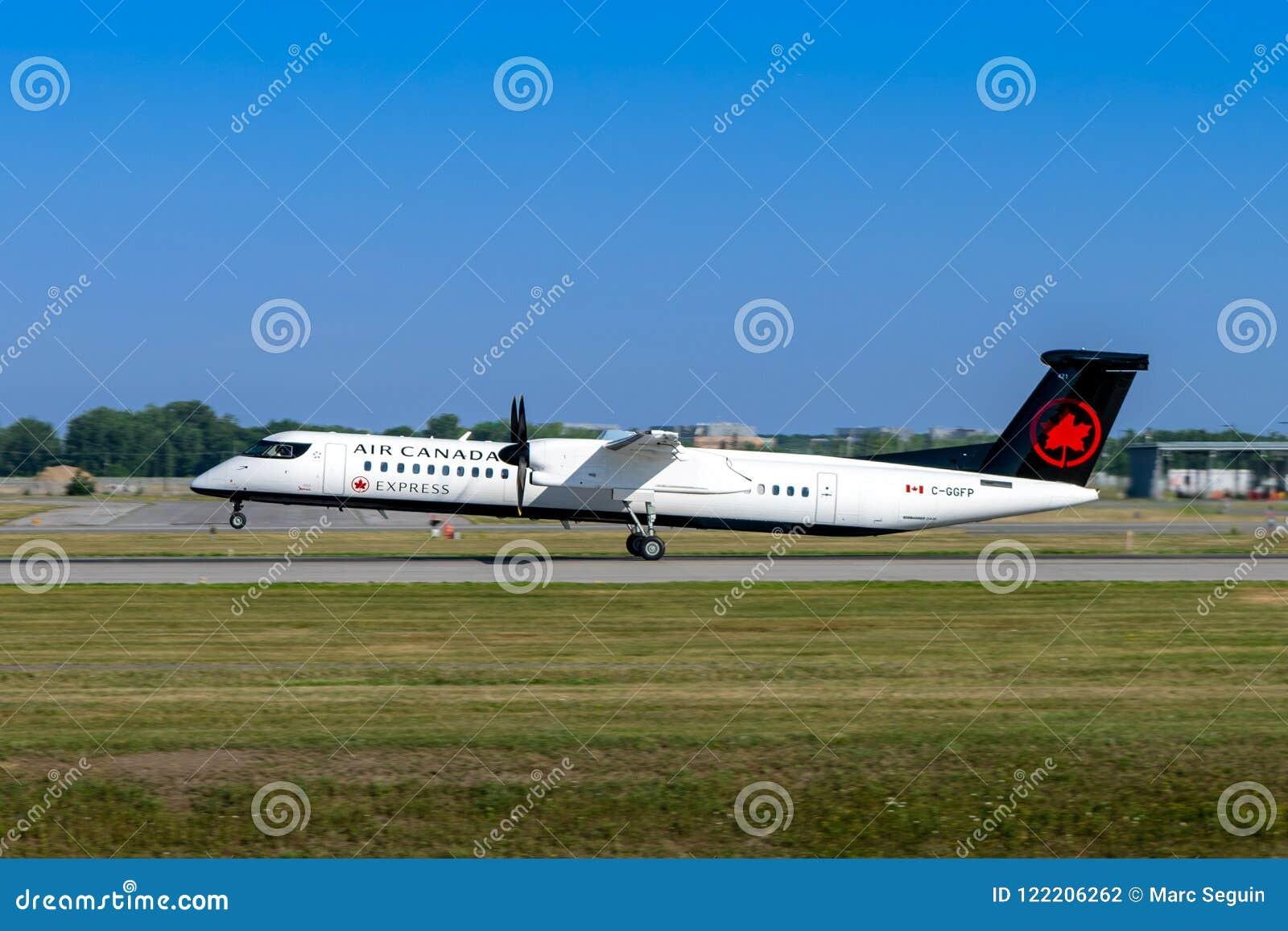 Montreal, Quebec, Canada - Juli 20, 2018: Een Bombardier Streepje 8 Q400 van Uitdrukkelijk Air Canada, door Jazz Aviation LP in w