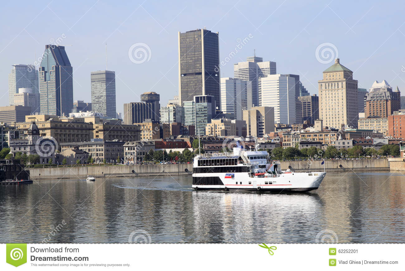 Montreal skyline and cruise boat reflected into Saint Lawrence River, Canada