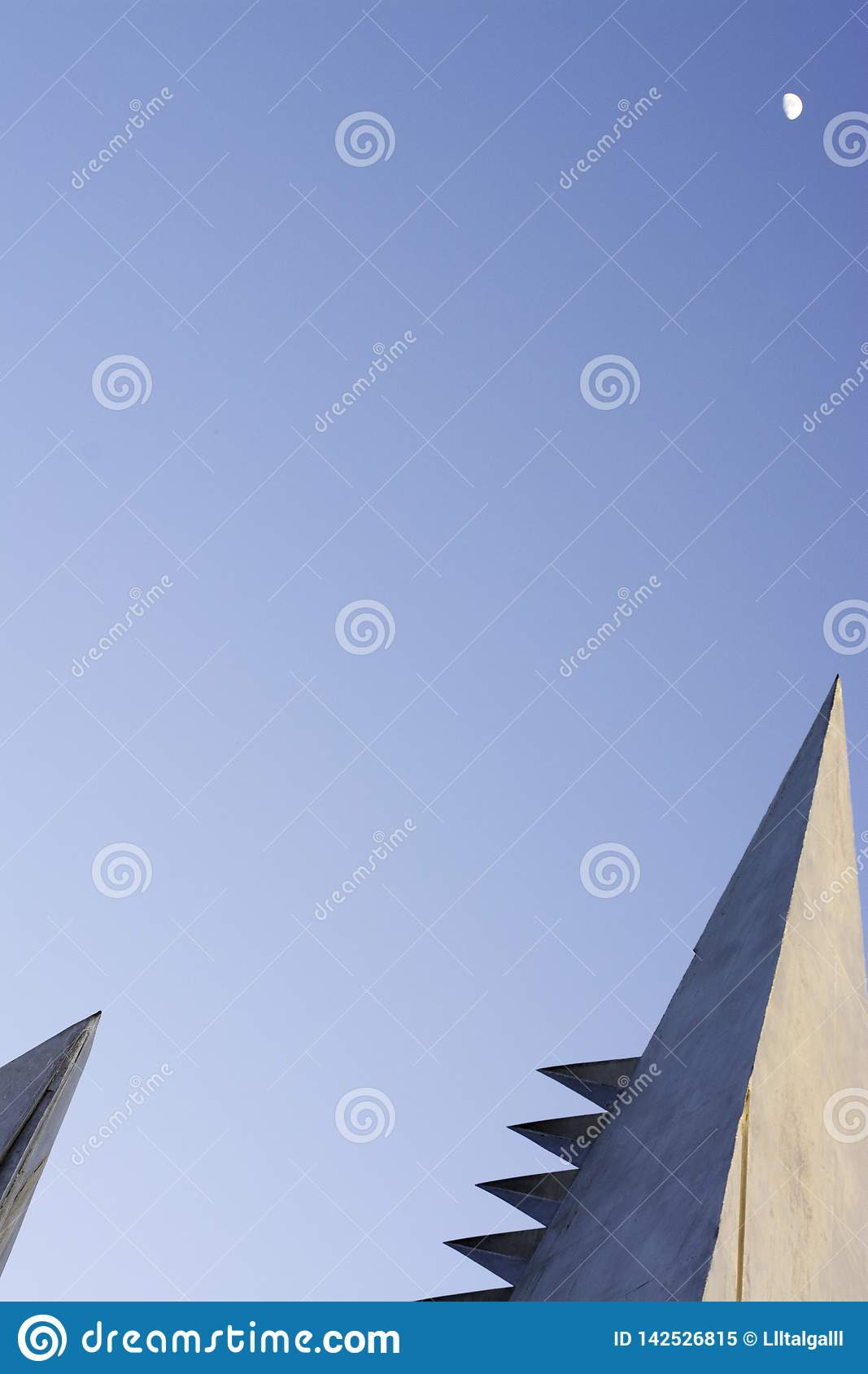 Blue sky with architectural elements.