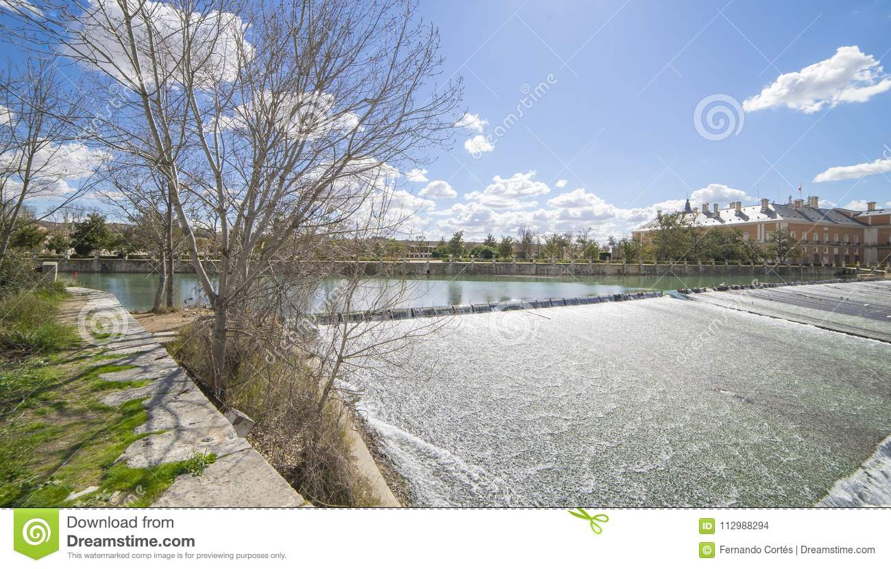 Monument, The Tajo River next to the Palace of Aranjuez. waterfalls with ducks and geese