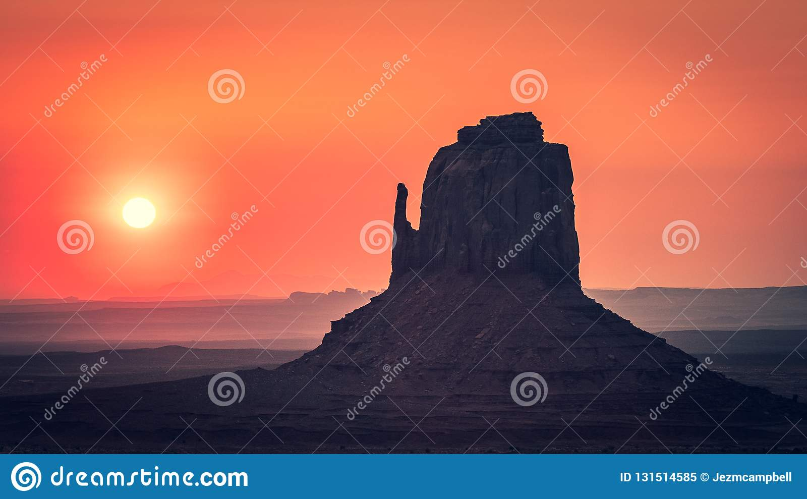 Sunrise behind the East Mitten, Monument Valley