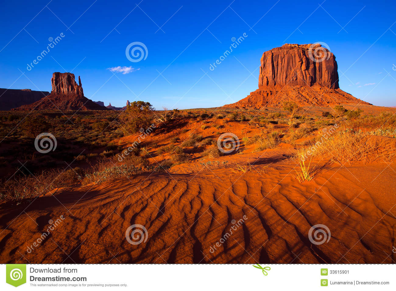 Stock Image: Monument Valley West Mitten and Merrick Butte desert sand ...