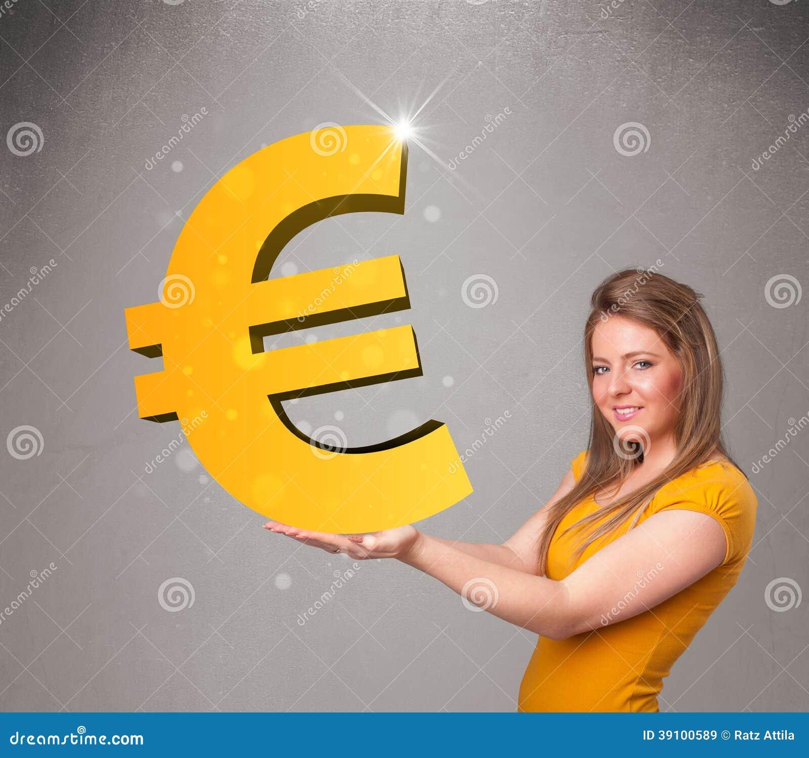 Mooi meisje die een groot 3d gouden euro teken houden
