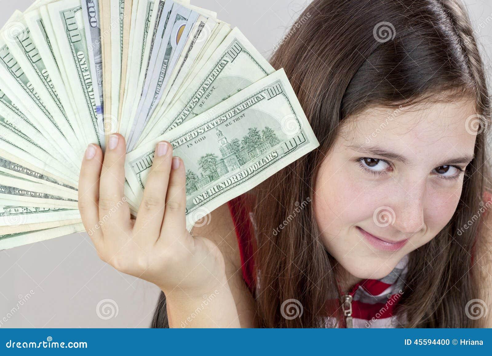 Mooie de holdingsamerikaanse dollars van het tienermeisje