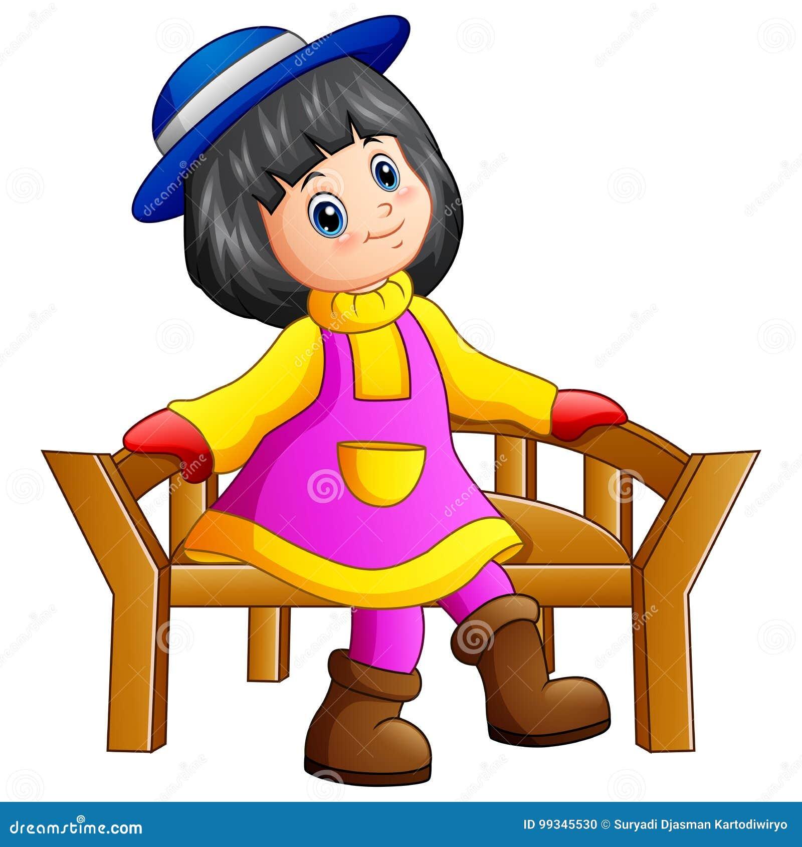 Mooie meisjezitting op houten bank