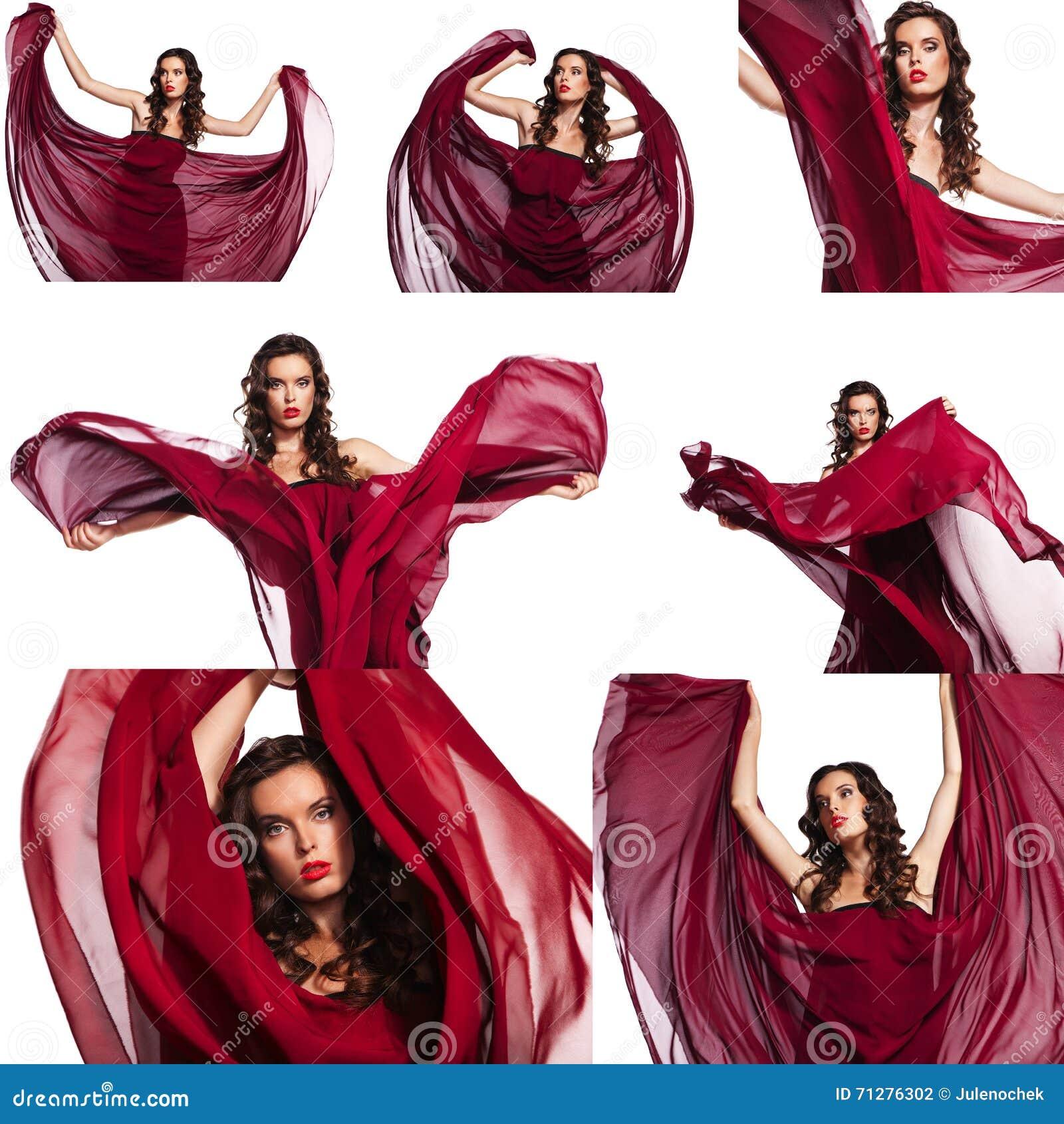 Mooie vrouw in het rode lange kleding geïsoleerd stellen met golvende stof