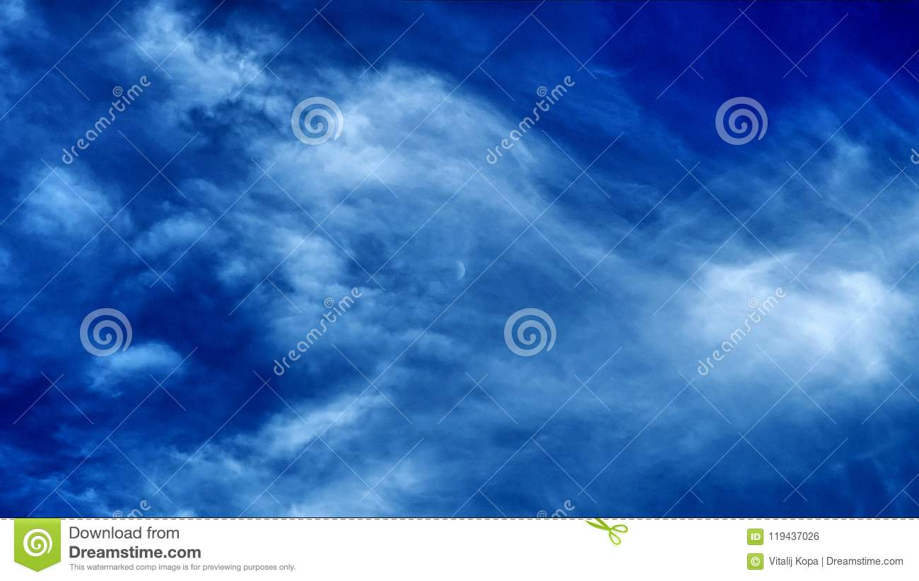 Moon and clouds on blue sky