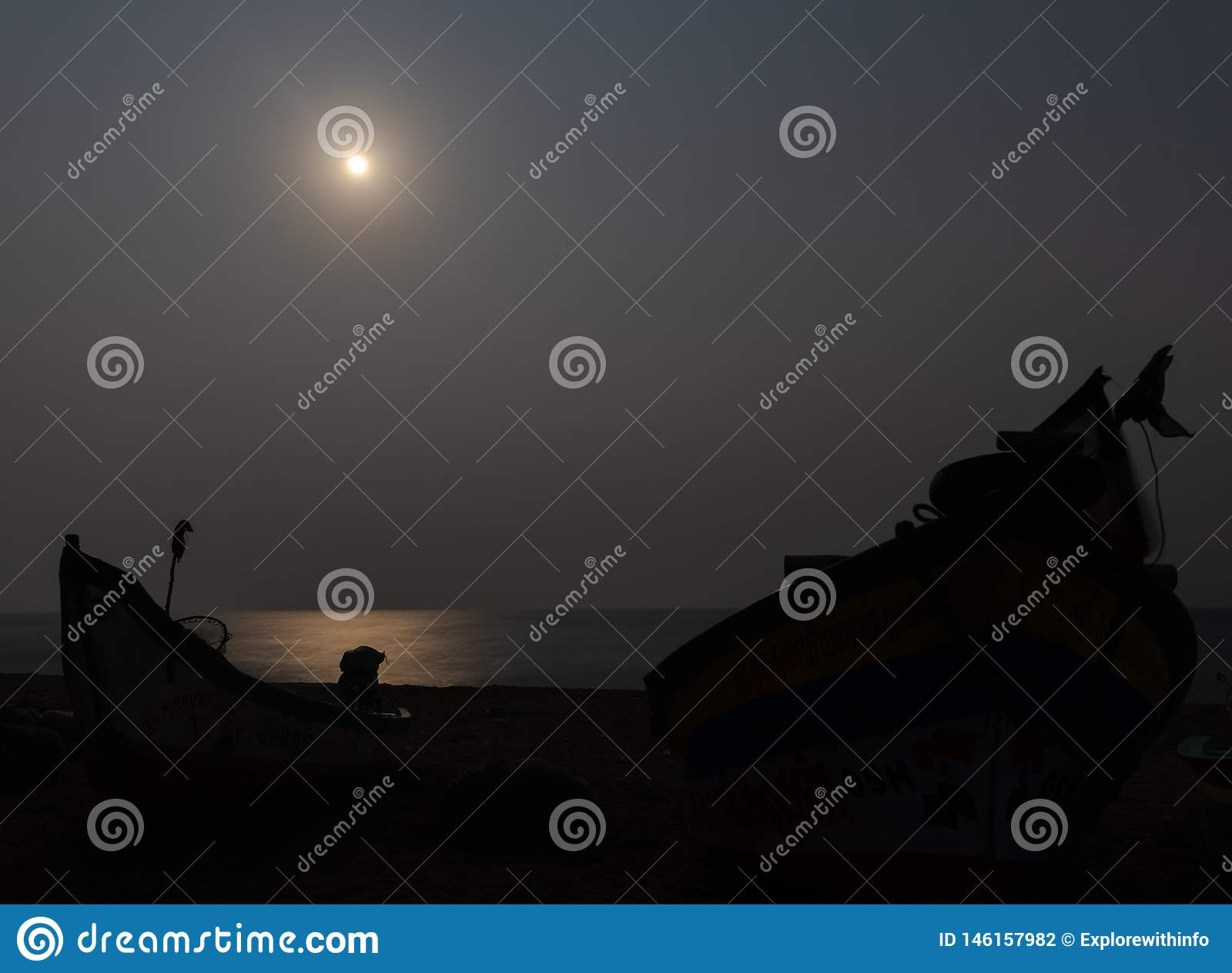 Moon light at seashore with fisherman boat shadow
