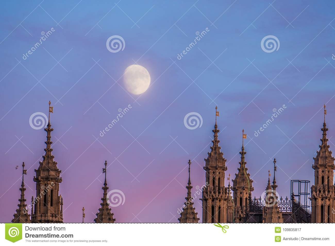 Moon Over Houses Of Parliament And Westminster Palace In