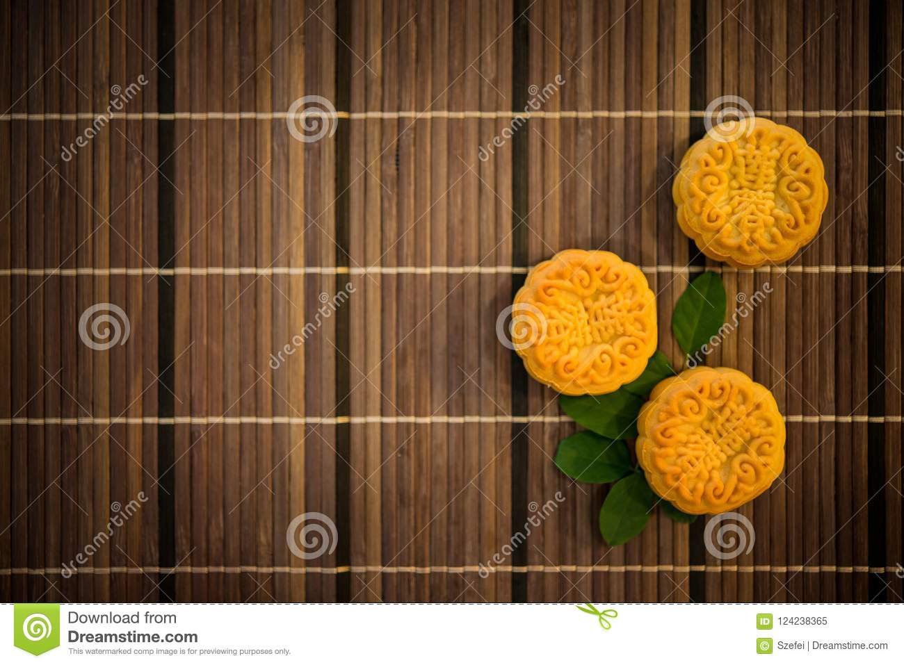 Top Down Moon Cakes On Bamboo Mat With Copy Space Stock Image