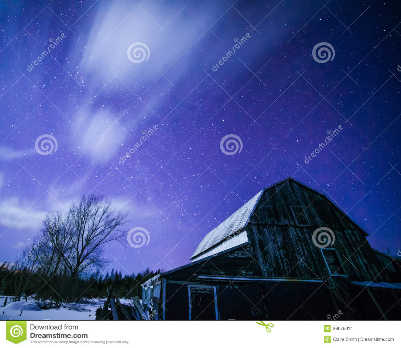 Moonlit barn with stars and clouds in winter