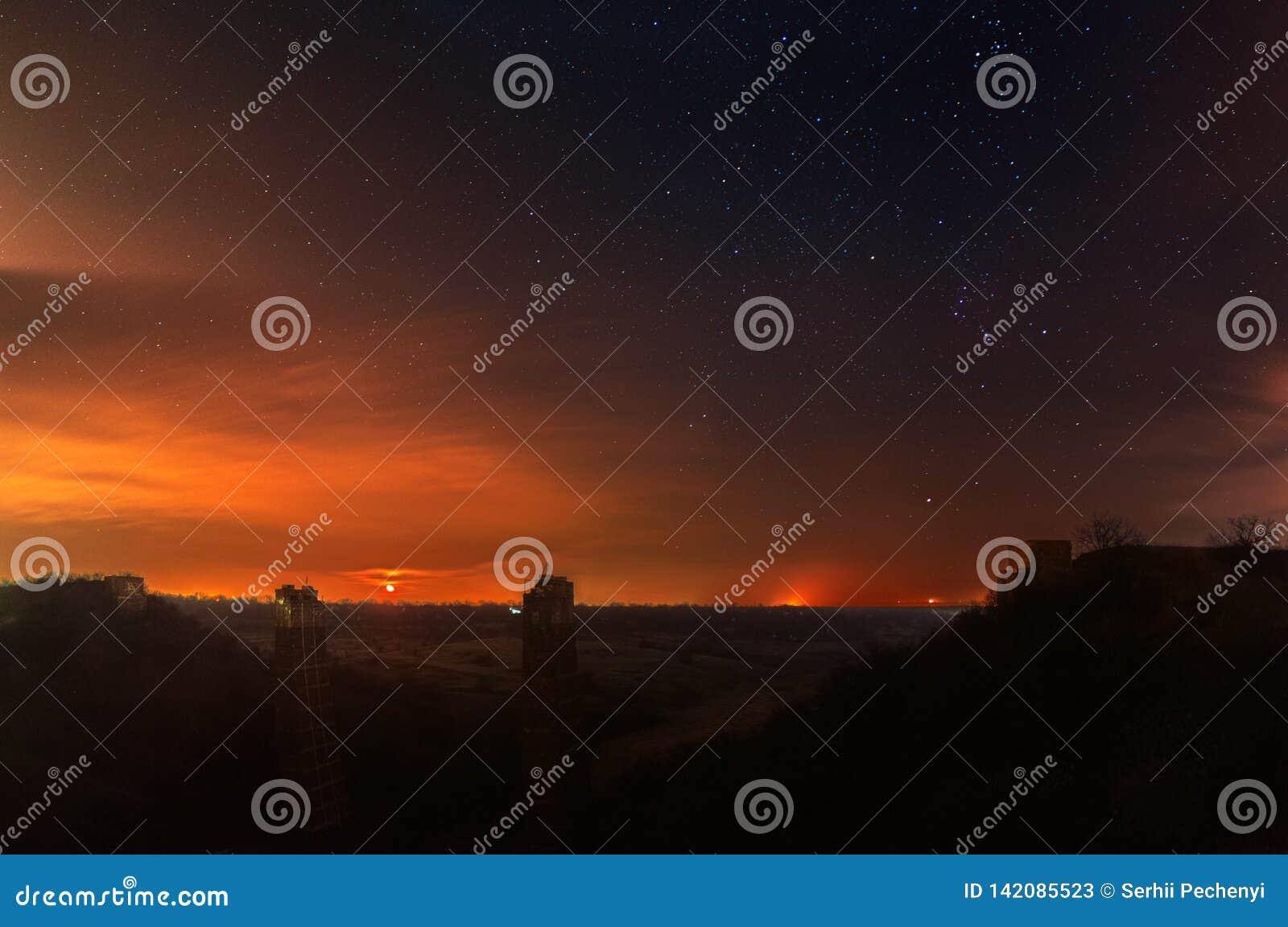 A moonrise photography. A fallen bridge ruins landscape. Starry Sky background